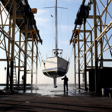Man cleaning a sailing boat