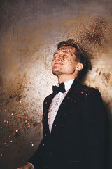 Men dressed in a suit and glitter
