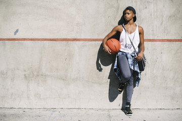 Young black woman holding a basket ball