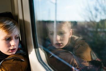A tween boy on a train