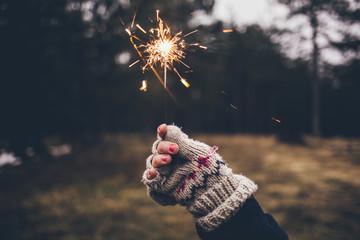 Hand in Glove Holding a Sparkler