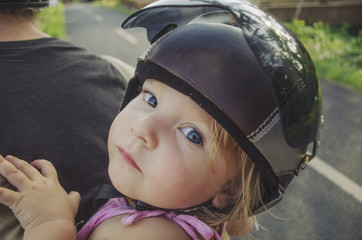 Close up of small child on the back of scooter