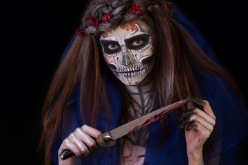 Beautiful girl with scary Halloween make-up