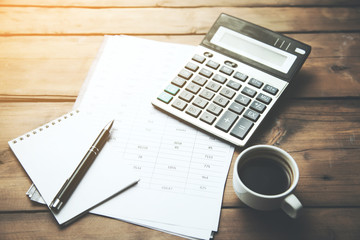 calculator with cup of coffee on financial newspaper