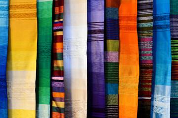 Multicolored fabrics in a Moroccan souk