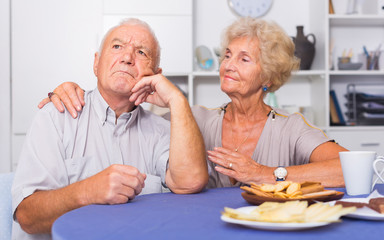 Elderly woman trying to apologize to offended man