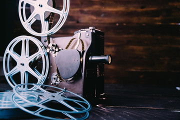 Retro 16mm film projector and film rolls