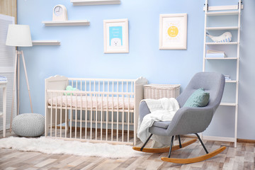 Baby bedroom design with white crib and rocking chair