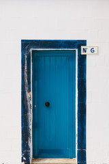 Blue Door on a White Traditional Facade