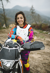 Young happy woman with her motorcycle