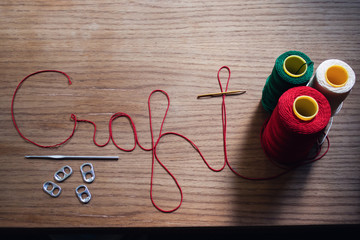 The words craft spelled out in yarn and other crafting items