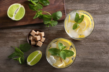 Composition with fresh mojito cocktail on wooden background