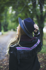 Back view of a fashionable young woman