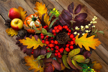 Thanksgiving arrangement with rowan berries and oak leaves, top view