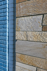 Detail of painted blue,  brick and masonry building wall