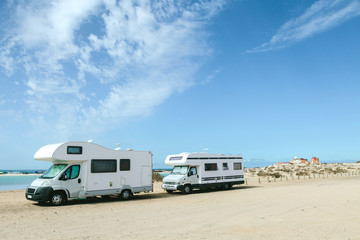 Campers Parked in a Sandy Beach