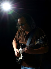 Male Guitarist Portrait in Lo Key Color