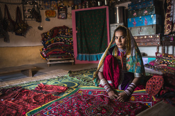 Young woman from Meghwal tribe showing handicraft