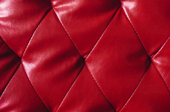 Faux red quilted leather background