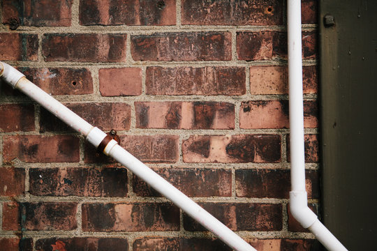 pipes on a brick wall