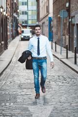 Businessman walking in an alley