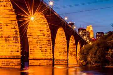 Stone Arch Bridge under autumn sunset