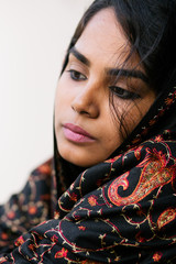 Young woman wearing a beautiful shawl in winter