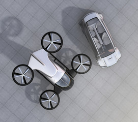 Top view of self-driving car and passenger drone parking on the ground. 3D rendering image