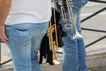 Asti, Italy - September 10, 2017: A couple of trumpets in the hands of trumpeters