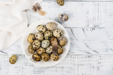 Quail eggs on white plate. Rustic style