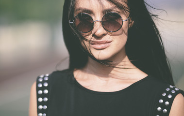 trendy woman with round sunglasses