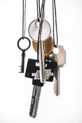 Some keys hanging on white.