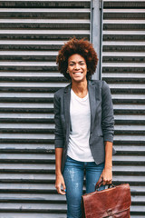 Portrait of afro american businesswoman standing outdoors.