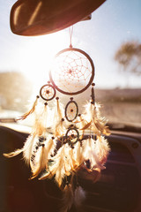 Dream catcher hanging from a car rear view mirror