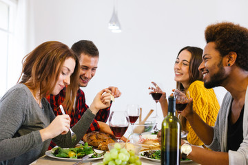 Group of friends having lunch at home.
