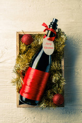 Picture of bottle of wine with card in wooden box