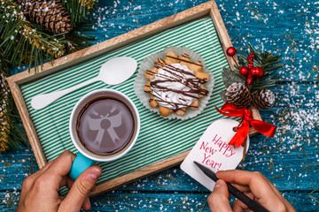 New Year's photo of tea with image of bow and cake