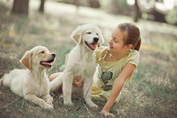 Retriever pup Lovely scene cute young teen girl enjoying posing summer time vacation with best friend dog ivory white labrador puppy.Happy airily careless childhood life world of dreams with puppies