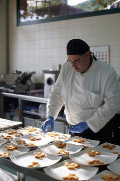 Chef preparing spanish christmas dessert for a feast