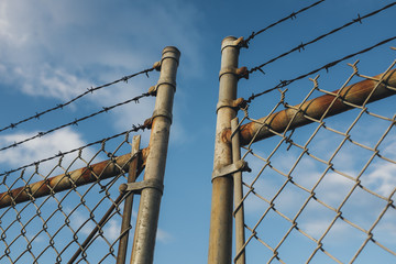 Detail of barbed wire and chain-link fence