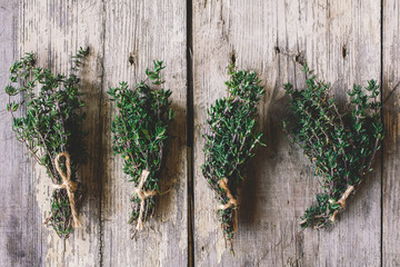 Thyme herb bundles on wooden table