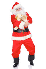 Santa Claus keeping teddy bear isolated on white background. Full length portrait