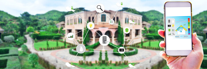 Hand holding smart phone for use application for control smart luxury mansion with infographics background - Smart home technology of concept