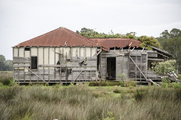 Deserted old wooden farm house