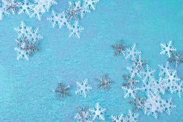 Many snowflakes on the blue background. Horizontal