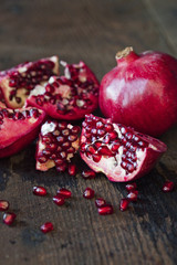 Broken Pomegranate on Wood Surface