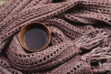 Drinks: cup of cocoa wrapped in a brown shawl