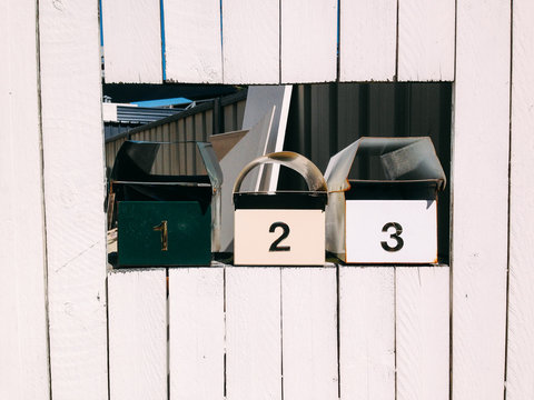 Letter boxes on a wooden wall