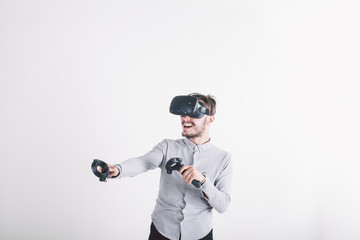 boy in virtual reality headset on white background smiling