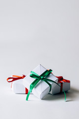 Three small gift boxes tied with ribbon - vertical with copyspace